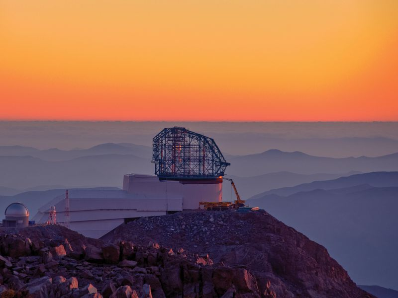 "The Vera C. Rubin Observatory, under construction in May 2019, promises to reveal more objects faster than any previous telescope. The photo was taken from Gemini South, another large telescope on Chile's Cerro Pachón mountaintop, a popular site due to its dry air and excellent astronomical ""seeing."" (LSST Project / NSF / Aura)"